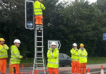 How many people does it take to change a traffic light bulb?